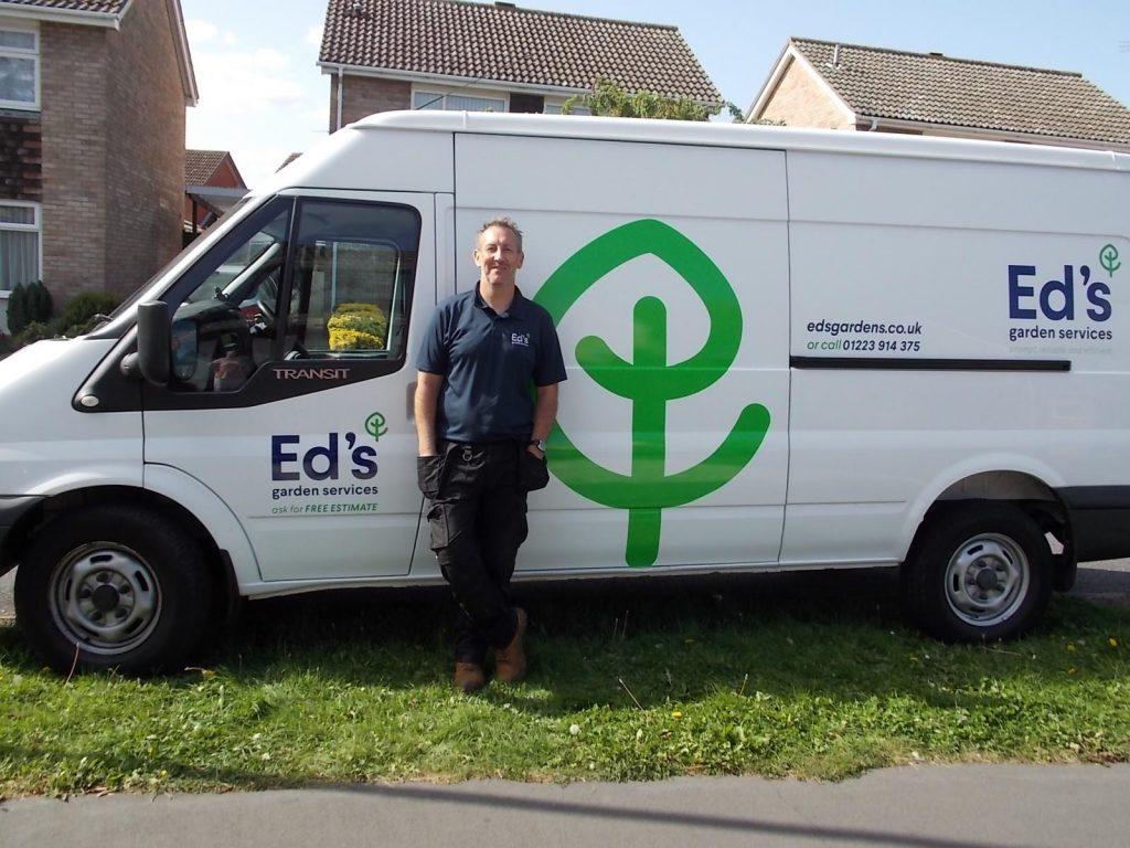 Ali's in front of his Ed's gardening van